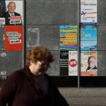 Merkel gets early election test with Saarland state poll